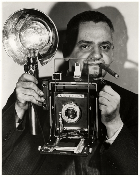 Weegee with his speed graphic camera