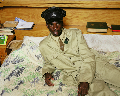 Pieter Hugo - Charles Mokwena, a member of the Zion Christian Church, in his bedroom, 2007