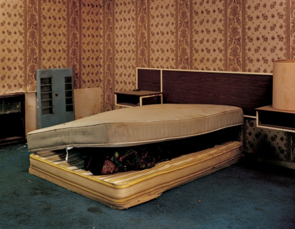 Taryn Simon: Larry Mayes. Scene of arrest, The Royal Inn, Gary, Indiana Police found Mayes hiding beneath a mattress in this room Served 18.5 years of an 80-year sentence for Rape, Robbery, and Unlawful Deviate Conduct, 2002